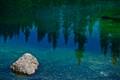 Reflections in Lago de Carezza, Italy