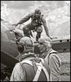 Having survived his mission, an F4 Wildcat pilot retruns