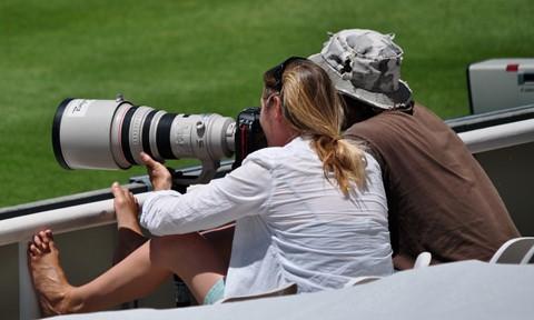 FemalePhotographerAtCricketMatch