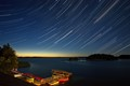 Starry dawn over lake Plateliai