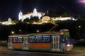 Tram under the castle at night