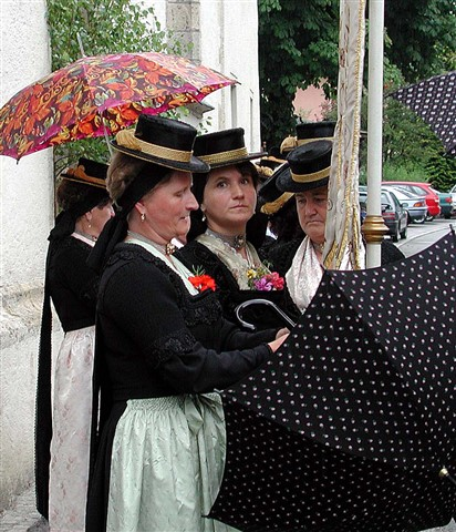 Austrian Farmer Women with Umbrellas