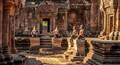 Sculptured Monkeys sit in the courtyard of Bantey Srei Siem Reap Cambodia.