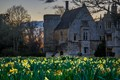 Taken at Southwick Hall near Oundle, UK.  The grounds in front of the hall are covered in Daffodils.  I was a little late in the season but they still looked pretty good.  Had hoped for more high clouds to reflect the sunset.
