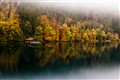 Foggy Autumn lake reflection.