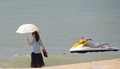 One boat one umbrella and a lady