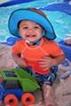 My grandson full of joy while playing at the beach in Pensacola Florida with his little dump truck and shovel!