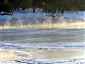 Light illuminate frozen Mississippi River