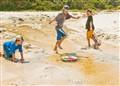 3 kids on beach