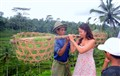 Tourist tried to share the burden of a Bali farmer