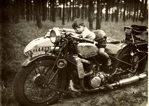 Small boy, motor cycle Berlin Germany.