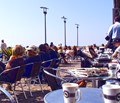 Enjoying a beautiful summer morning by the Öresund at Espresso House in the Western Harbor in Malmö, Sweden.