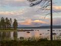 Sunrise by lake Isteren, Hedmark county, SE Norway, and a golden cloud caps Mt. Rendalssølen/1755m ASL.