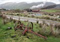 Old grass cutter lies out of use in North Wales.