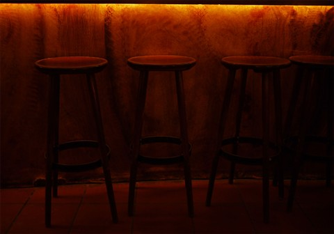 Barchairs under candlelight II