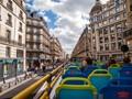 Riding the hop-on hop-off-bus in Paris.