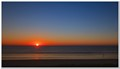 A peaceful start to the day as the sun rises over the Pacific. Southport, Queensland.
