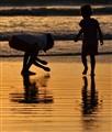 Barefoot fun during sunset