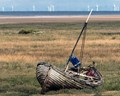This rowing boat /possibly sailing boat was seen at Thornham Harbour on the field away from other sea-worthy saiing boats.
