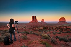 photographer in monument valley at sunset