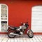 motorcycle and red wall IG