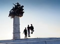 Three Boys Jumping in front of the Monument Dedicated to the heroes of the Independence war in Izmir, Turkey