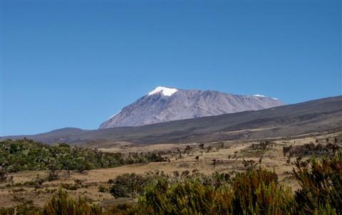 Mt. Kilimanjaro Behind Hills