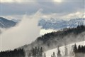 Wave of fog rolling up into the valley, Austria