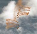 Army parachutists at an air show.