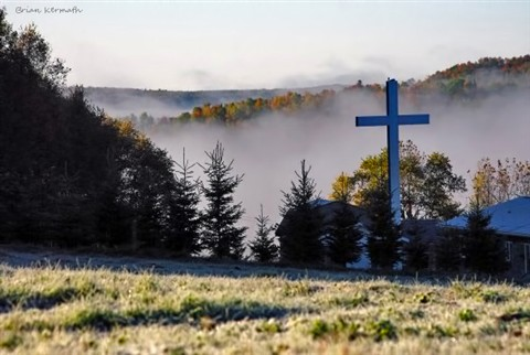 Cross in the frost and the fog in the early morning