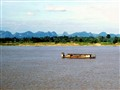 The village of Tot Ket, Laos and a River Barge on the Mekong River