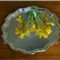 Daffodils reflected in silver salver