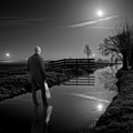 Man on water by moonlight