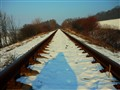 Winter railway with shadow of a photographer