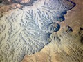 Water erosion patterns in Nevada desert (aerial photo, 33,000 ft)