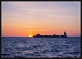 Container ship at sunrise in the North sea