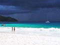 On the beach in the Seychelles watching an incredible tropical storm pass within a few hundred metres. I was in the sun the whole time!