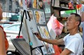 Street artist in action