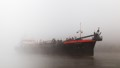 Hopper-Dredger Ijsseldelta Appears Out of Dense Fog.