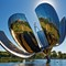 Giant Stainless Steel Flower: In Buenos Aires, Argentina this 23 meter tall stainless steel and aluminum flower has petals which open each morning and close at sundown.  Its formal title is Floralis Generica.