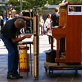 John Gill, ragtime pianist extraordinaire, photographed on 2 April 2011 in Perth WA adjusting his street piano. Less than two weeks later he passed away due to a massive coronary attack. Great talent, sadly missed.