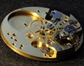 Dismantled pocket watch movement
