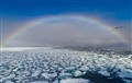 Rainbow on frozen sea