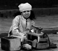 a child work as shoeshiner