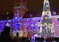 People celebrating Christmas in front of Warsaw Castle, Warsaw, Poland