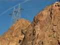 Checking the rock wall retention netting at Hoover Dam.