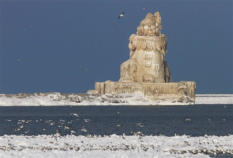 Frozen Lighhouse On The Lake