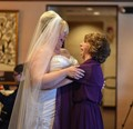 bride and her mom sharing a happy moment
