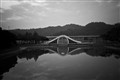 Duality - mirror image on a lake of a bridge-1