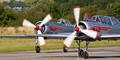 A Yak 50 and Super Yak 52, part of the Yakovlevs display team, preparing for take-off prior to a training flight.
